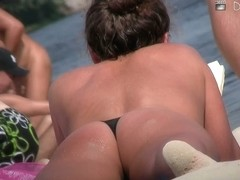 big and firm tits on the beach and a dissapearing thong