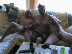 Blonde milf sucks and gives 2 of her friend a handjob on the sofa