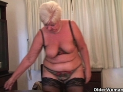 Fat granny in nylons plays with fake penis