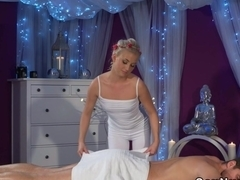 Masseuse rubbing big cock by her pussy