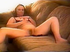 Chick is dildoing her twat on camera