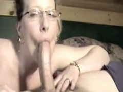 cute girl in glasses deepthroating strapon