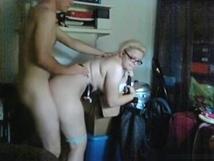 Nerdy glassed blonde gets doggystyle fucked in the living room