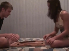 Russian girl Nastya and her classmate playing backgammon