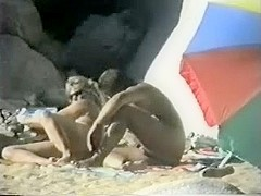 Voyeur spies on older couple having beach joy.avi