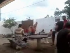 Naked latina gets her pussy eaten out by a fat guy on a table in a bar