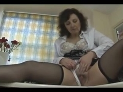 Attractive mature English babe strips and poses