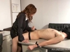 Delightful Japanese milf in an office suit gives hand work