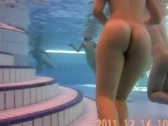 Underwater scenes of the nude chicks in the sauna pool