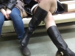 Girl catch stocking by the boot in subway