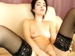 Sexy babe Isabellen fucks herself on a white couch