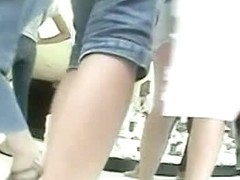 Plump ass clad in a denim skirt in this upskirt video