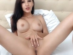 Tanned busty webcam girl plays with her delicious pussy