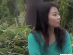 Stunning Asian chick getting her breasts revealed by some stranger