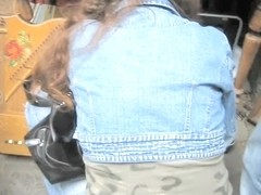 Girl in jeans outfit is on her hunkers showing candid ass