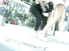 Sexy blond girl caught in a real street up skirt video.