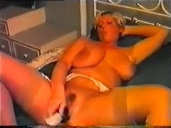 Mature lady with huge tits masturbates with toys.