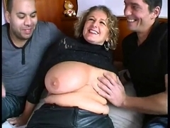 Breasty mommy receives drilled by two excited mates