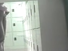 Charming Asian caught changing in the locker room
