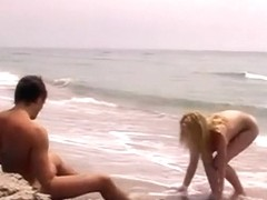 Blonde hotty riding at the beach