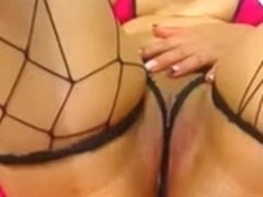 Bootylicious Colombian sweetheart in fishnet stockings masturbating