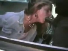 Darksome cop facefucks chained white wench in patrol car