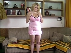 big beautiful woman golden-haired undresses and plays with sex-toy on divan