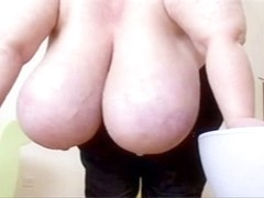 Mature with huge tits lets a younger boy have fun