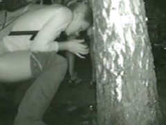Night time voyeur video of a nasty chick pissing behind a tree
