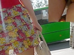 Sexy lassie upskirted sitting in the public transport