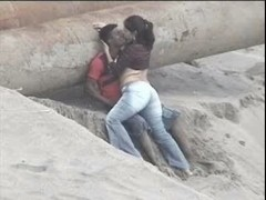 Latino pair caught on the beach