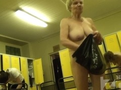 Granny with huge melons showing her trimmed pussy