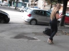 Spy beautiful blonde's ass in tight jeans and wedges