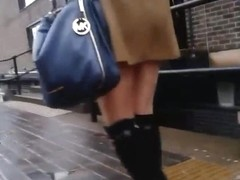 Sexy japanese girl in knee high boots