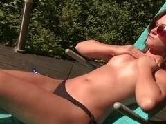 Tess Lyndon rubs lotion on her body and pussy