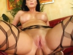 An absolutely stunning brunette with an amazing set of tits take a large cock in her ass.