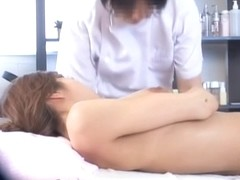 Busty Jap gets a creampie in spy cam massage video