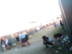 Kinky dude recording some females at a concert