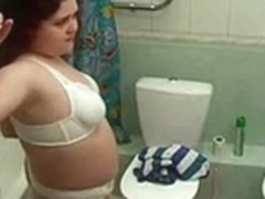 My chubby girlfriend in bathroom spied with hidden cam