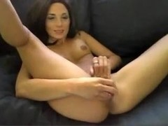 Amateur doxy masturbates moist crack on sofa