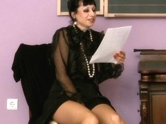 Brunette milf reads a letter and starts to masturbate