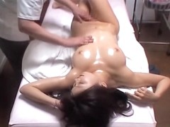 Booty Asian babe gets fingered by a skillful masseur