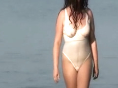 Chubby lady going into the sea
