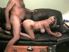 Blonde milf gets doggystyle fucked on the sofa and smokes a cig
