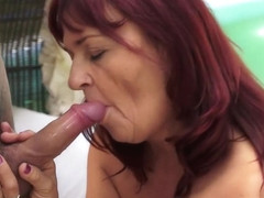 Wild redhead mature with big breasts has a young stud plowing her cunt
