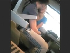 Voyeur captures a blonde jerking off her bf in a train