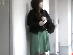 Whimsical little bimbo flashes her beaver when someone lifts her green skirt
