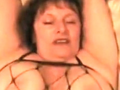 Busty milf in bed enjoys hard pussy fuck