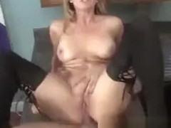 Naughty blonde mom in black stockings has a young stud banging her ass