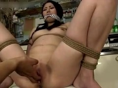 Tied Japan girl gets her ass and cunt fucked with toys